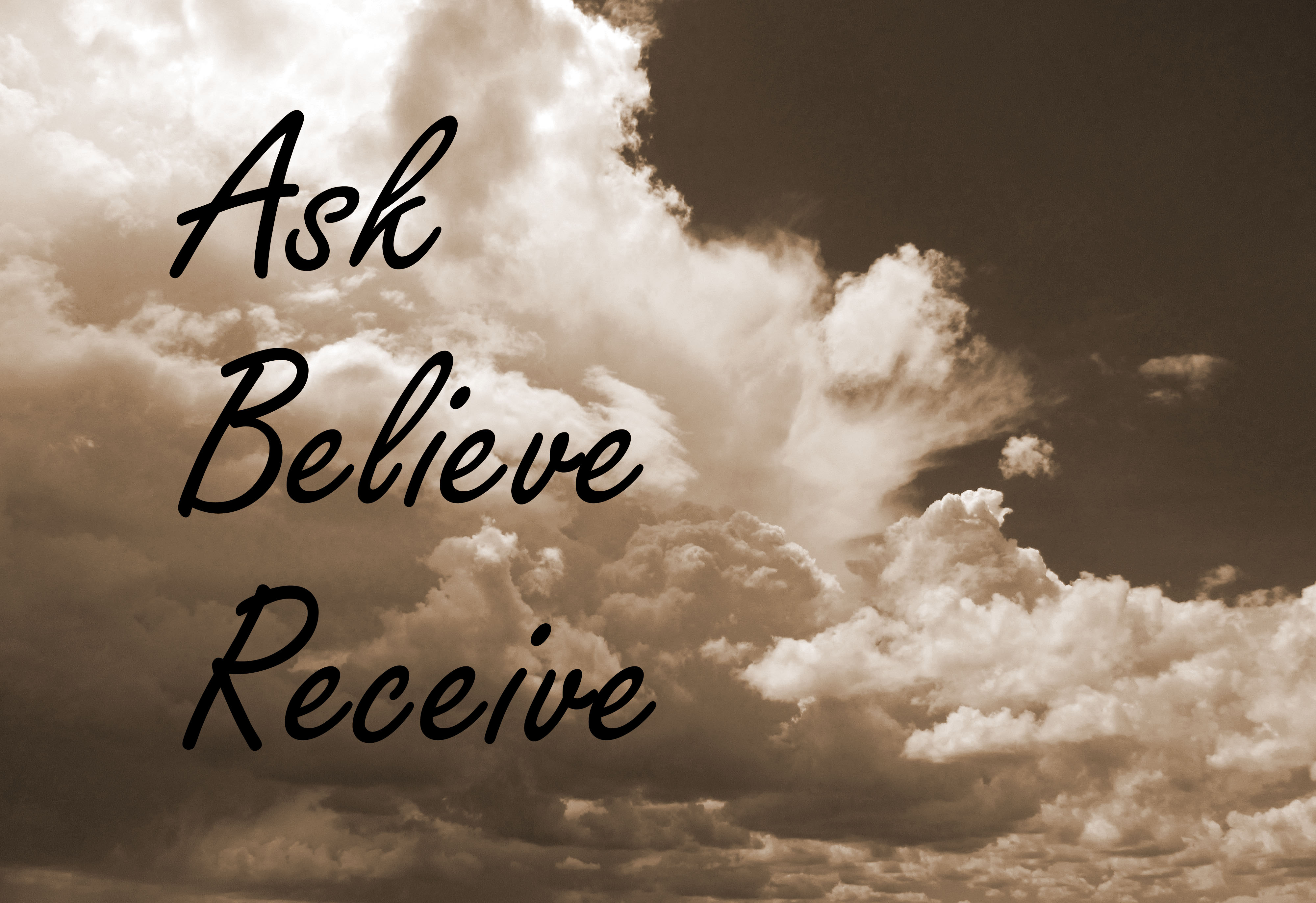 """""""Ask, Believe, Receive"""" written on sepia photo of clouds"""