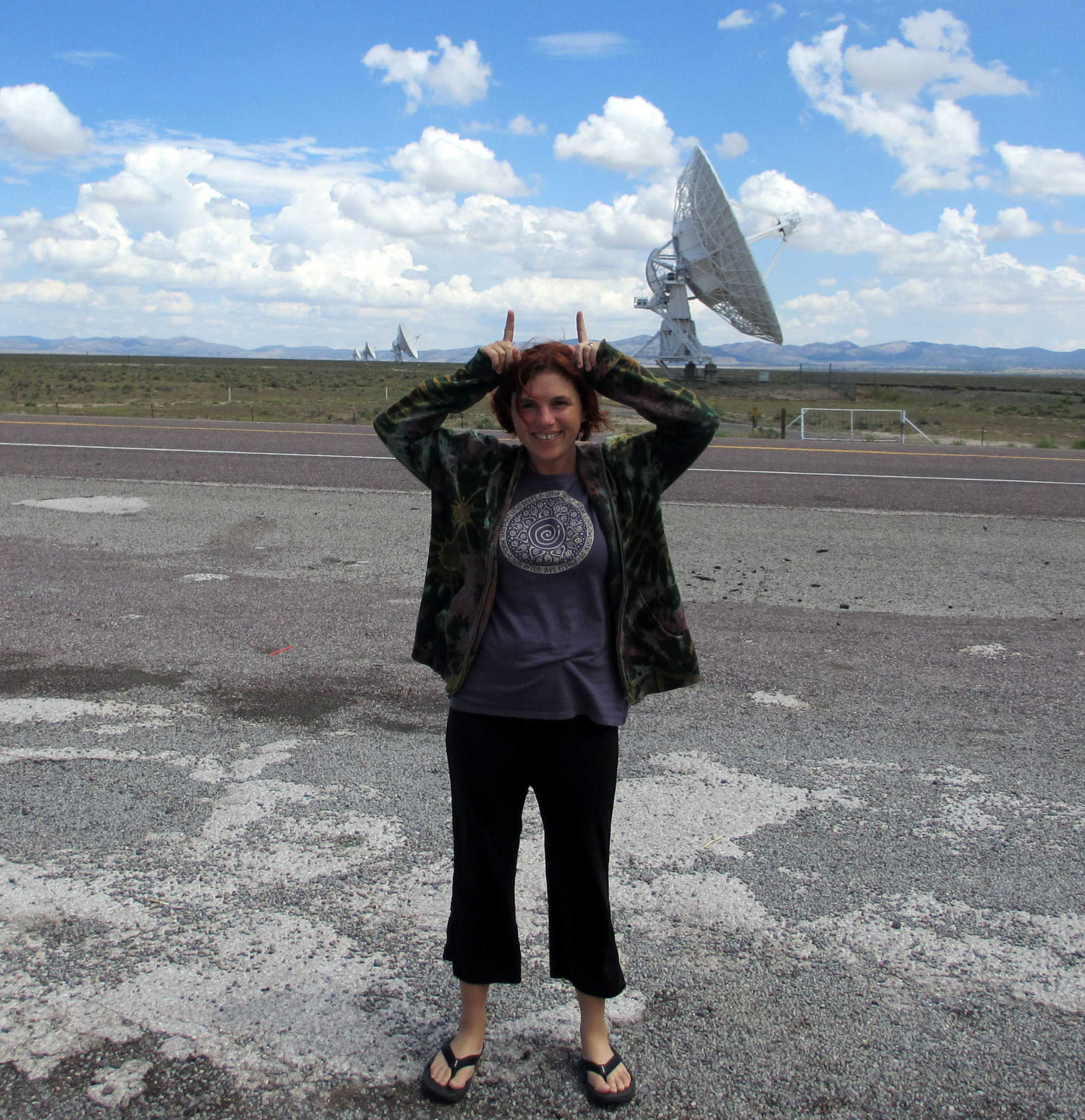 Me in New Mexico on a road with antennas in the background.