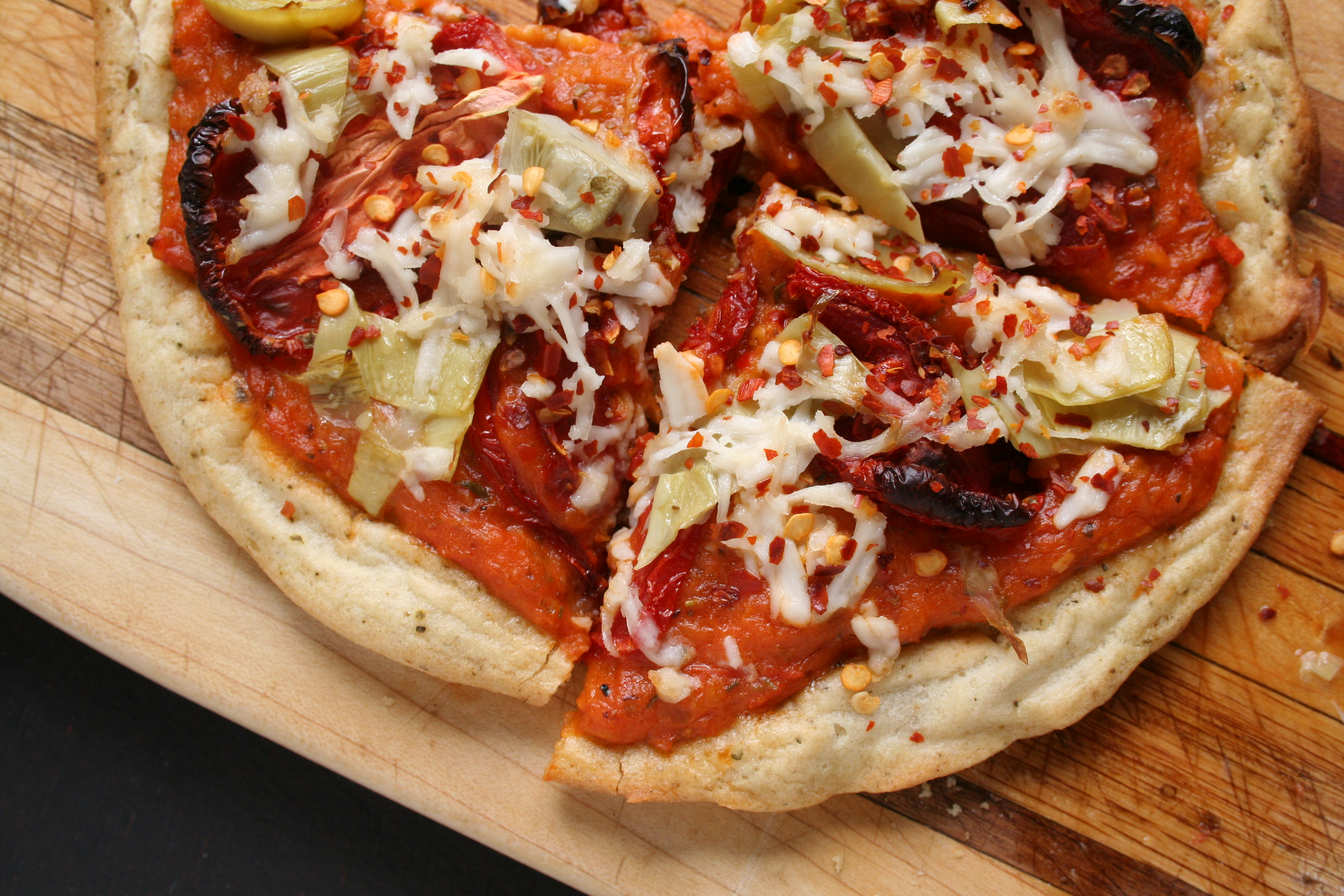 Pizza with Roasted Tomato Sauce, Sun-Dried Tomatoes and Artichokes