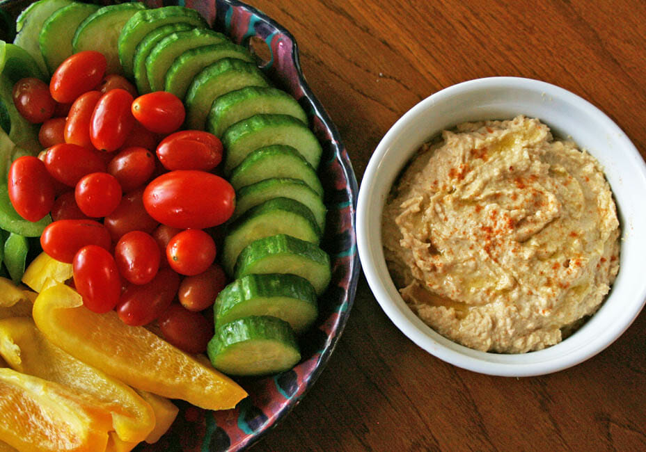 Roasted Garlic Hummus with plate of veggies.