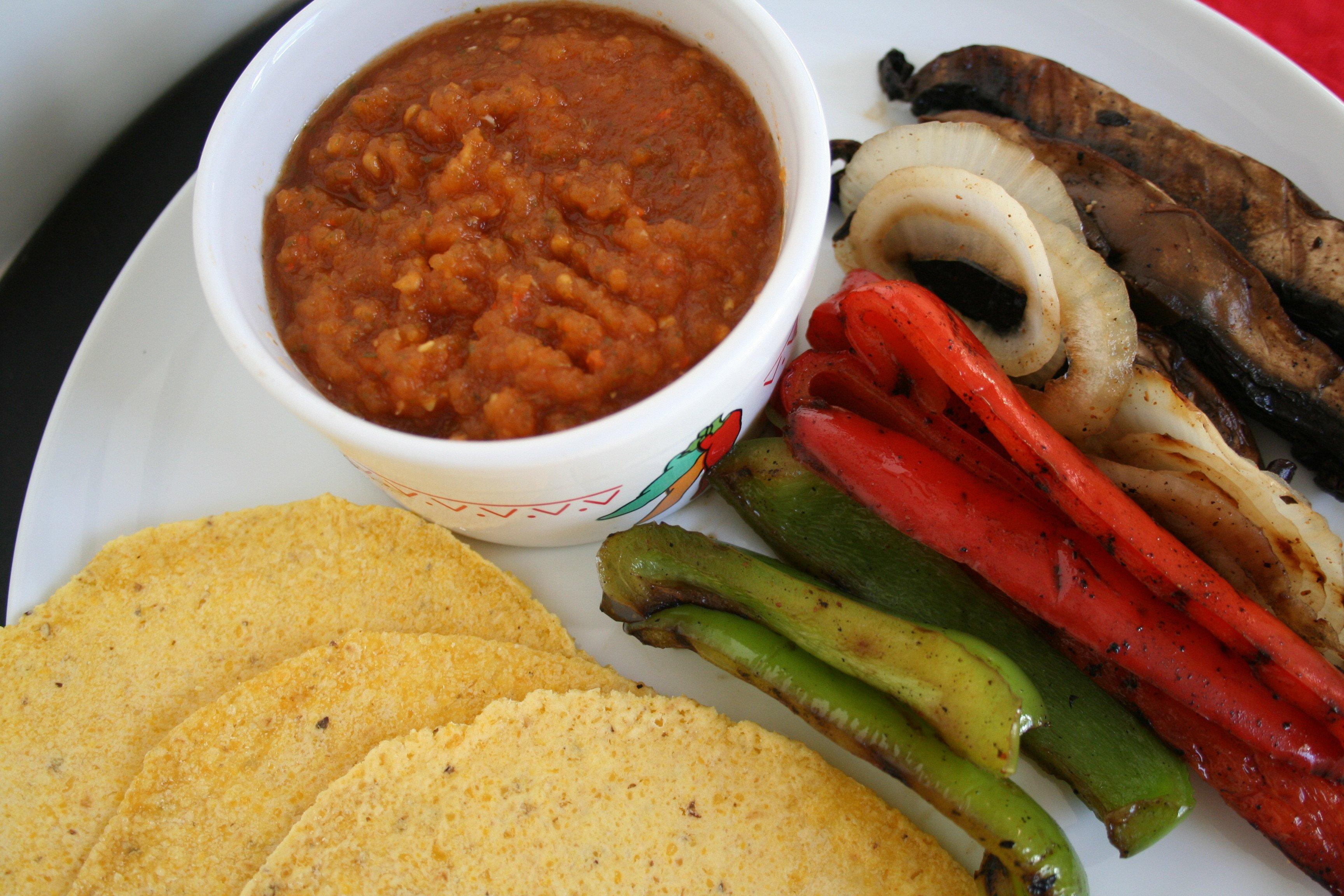 Salsa pictured with vegan fajitas.