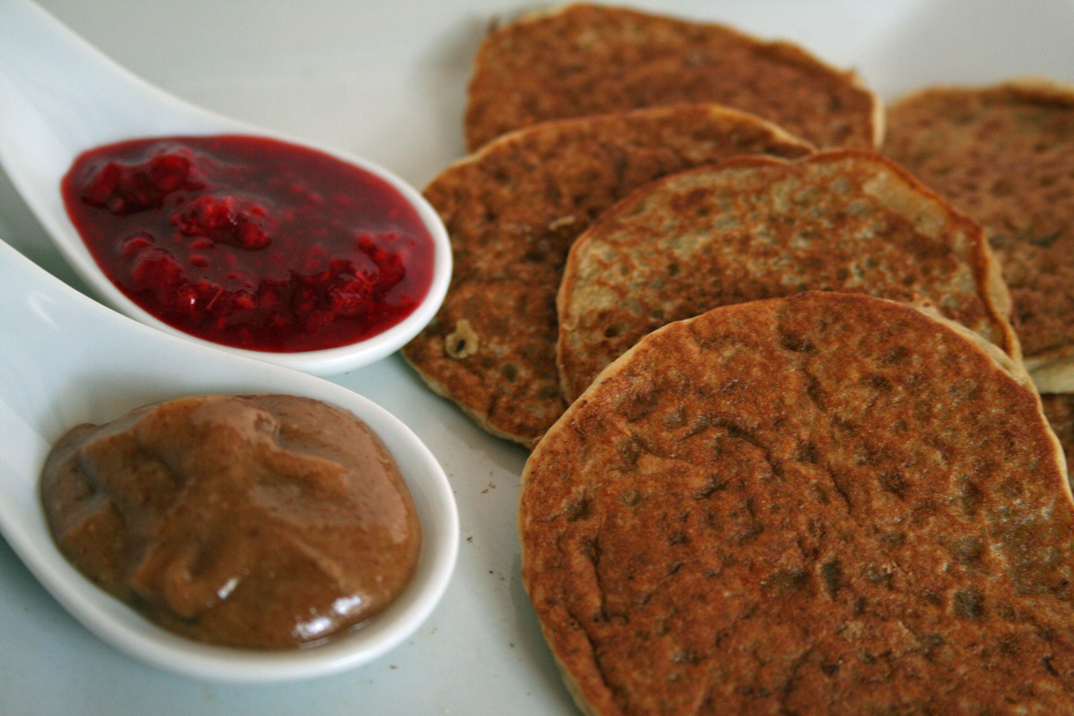 Banana Pancakes with Almond Butter Cream and Raspberry Syrup