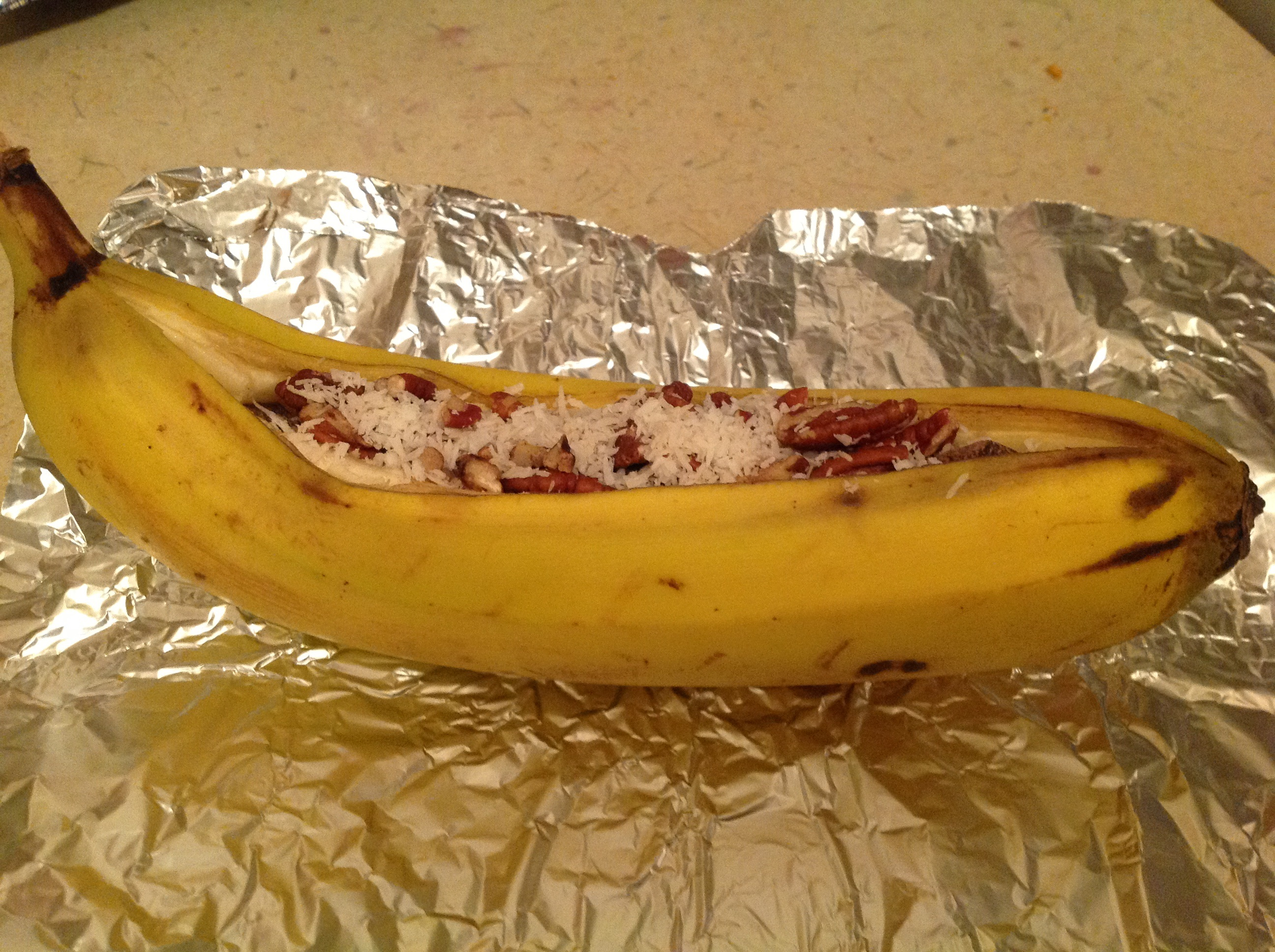 Campfire Stuffed Bananas on tinfoil before cooking.