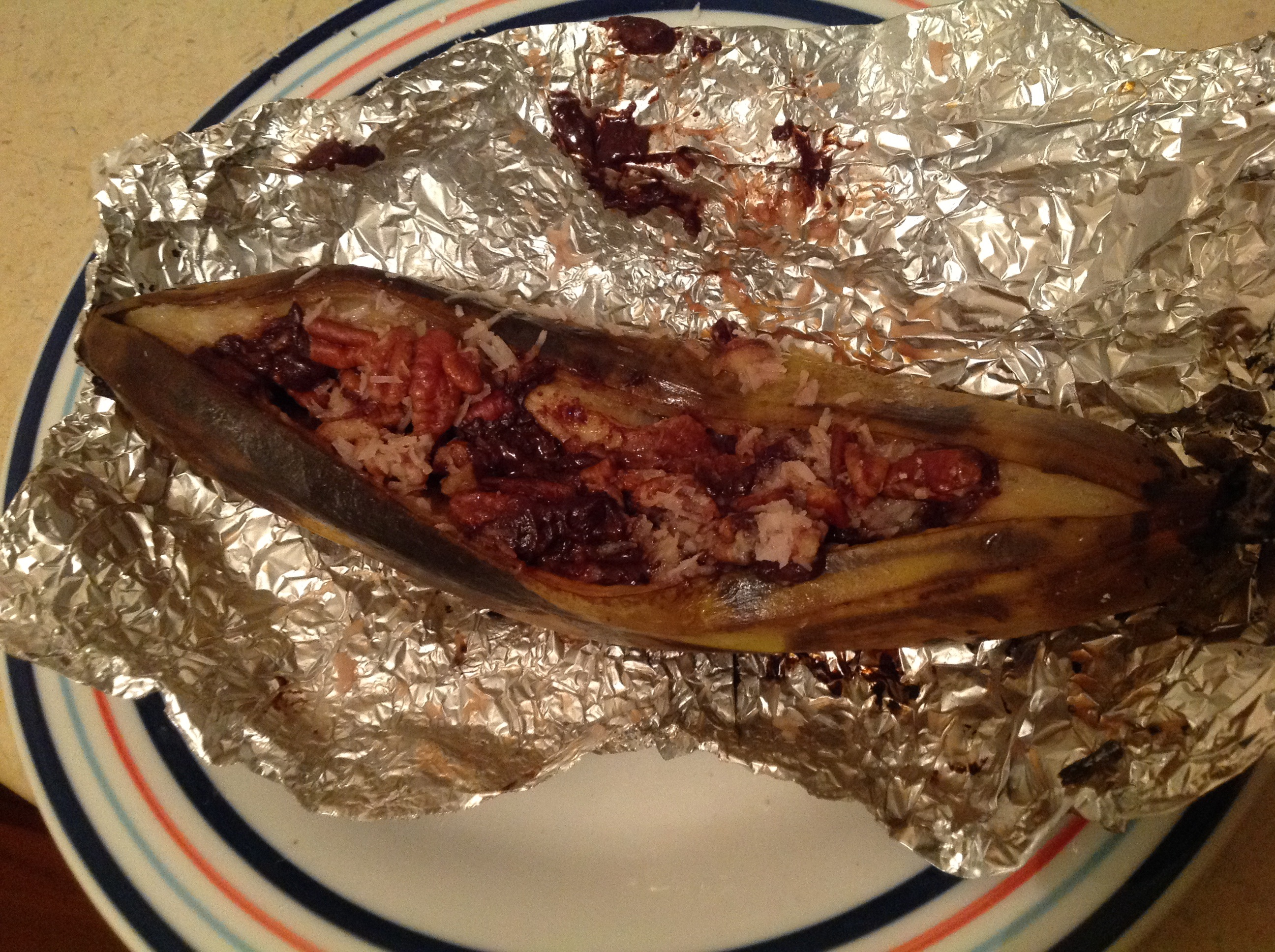 Campfire Stuffed Bananas on tinfoil after cooking.