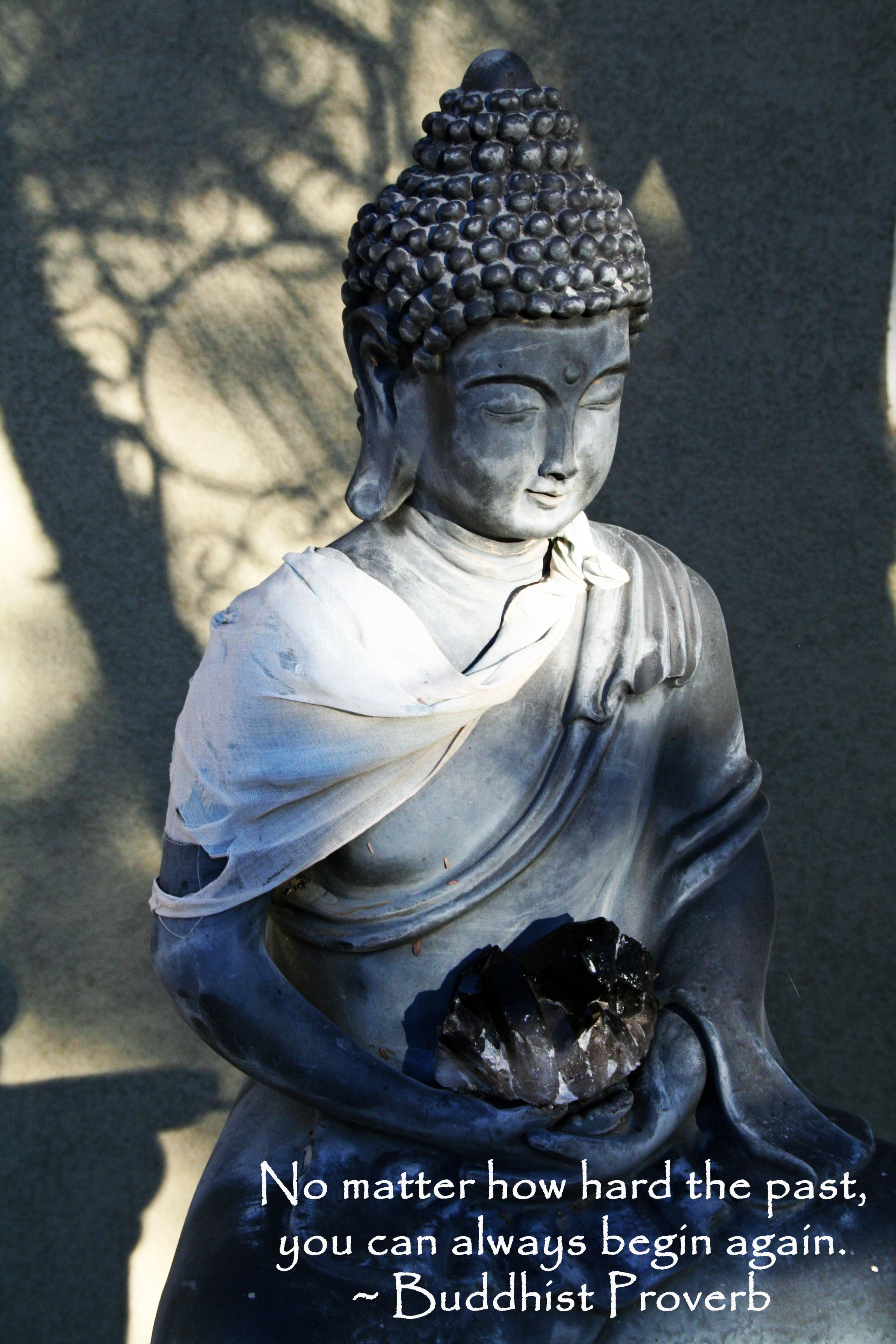 """No matter how hard the past, you can always begin again."" - Buddhist proverb on a photo of a buddha."