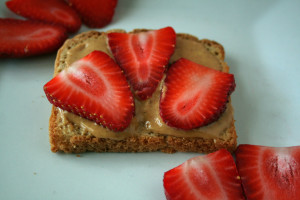 Peanut butter and sliced strawberries on toast.