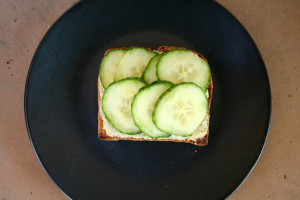 Hummus and cucumber slices on toast.