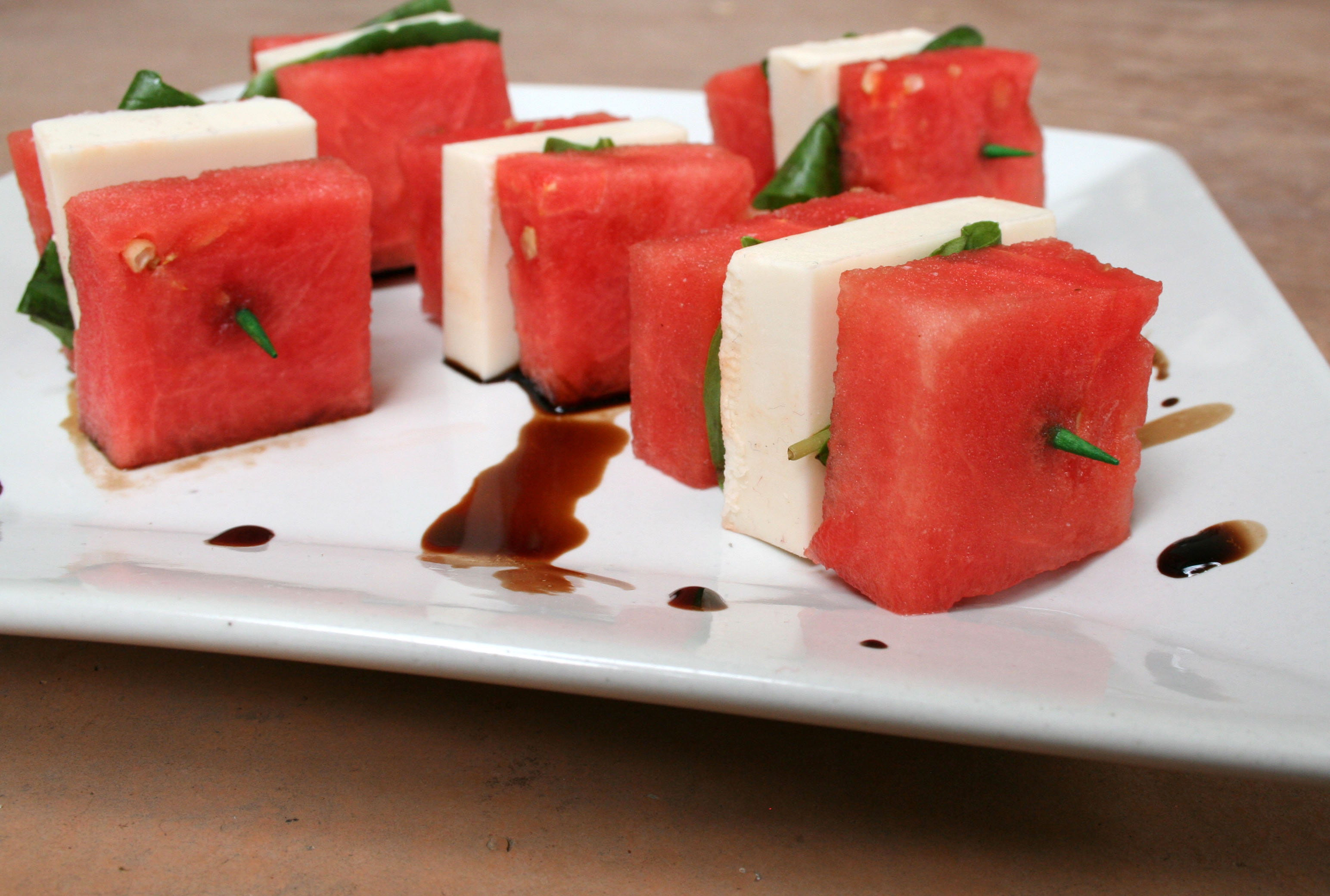 Watermelon and Vegan Mozzarella Skewers with Balsamic Reduction