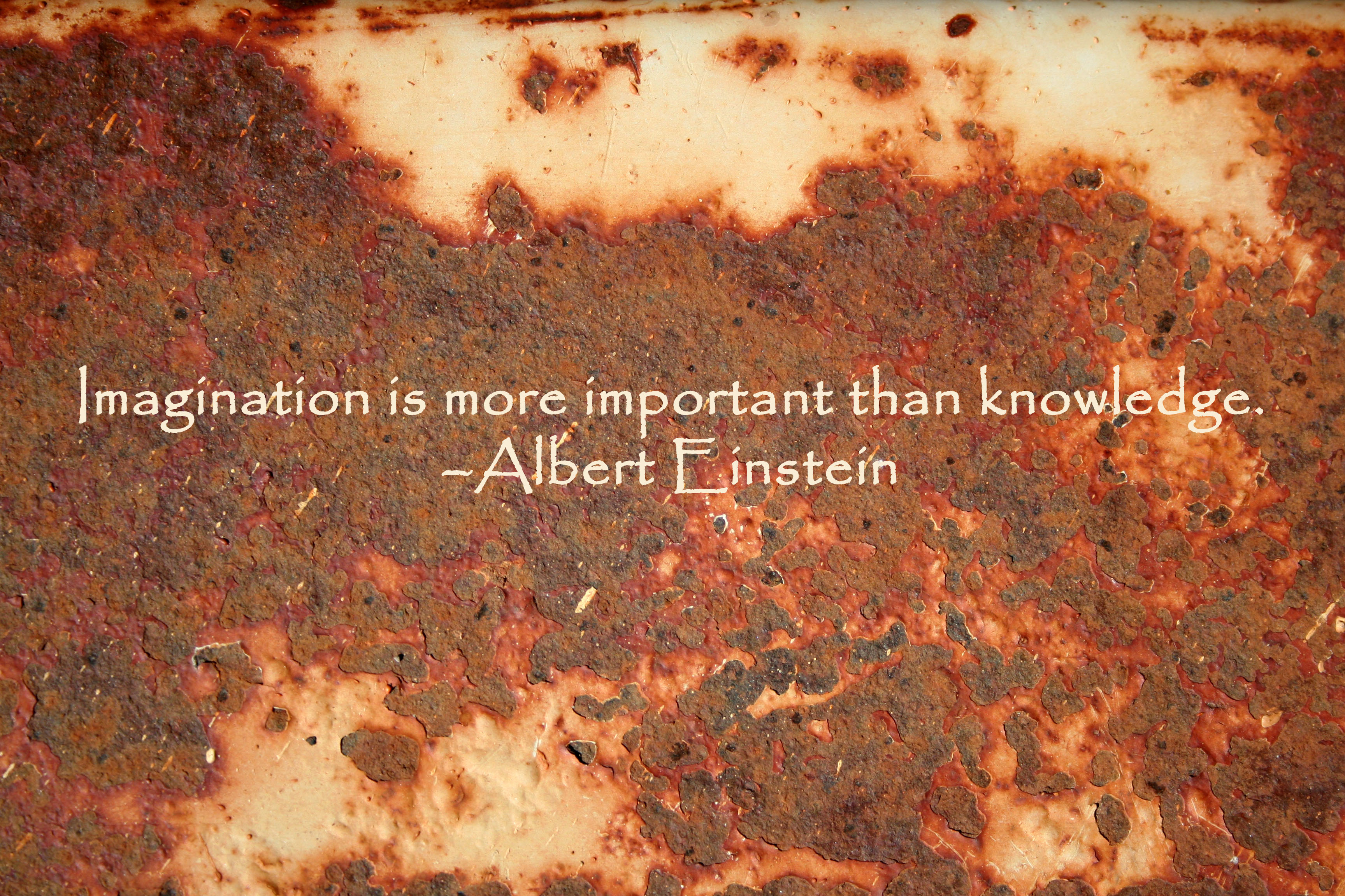 """""""Imagination is more important than knowledge."""" - Albert Einstein quote on a photo of rusted metal."""