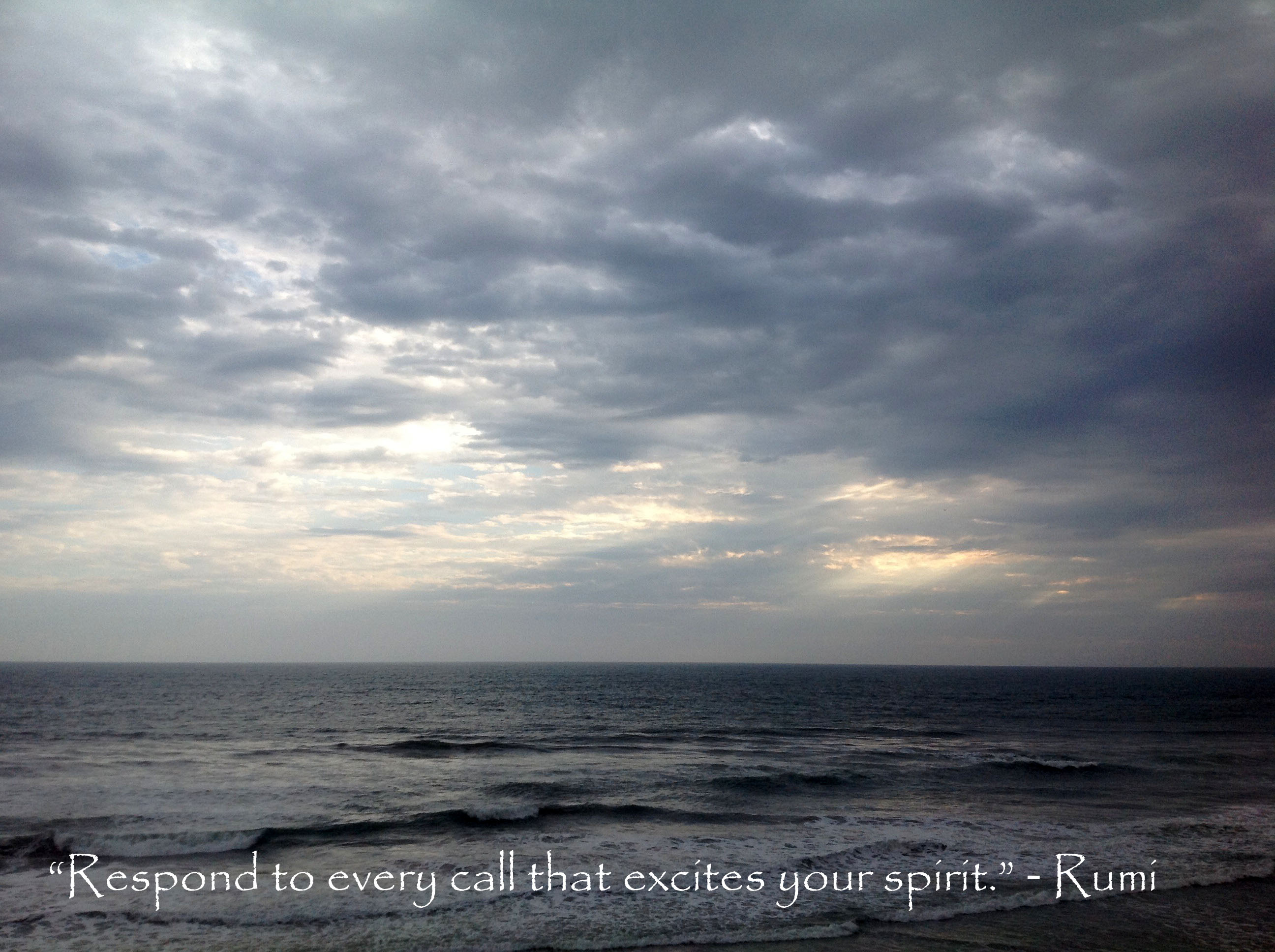 """""""Respond to every call that excites your spirit"""". - Rumi quote written on a photo of sunset over ocean."""