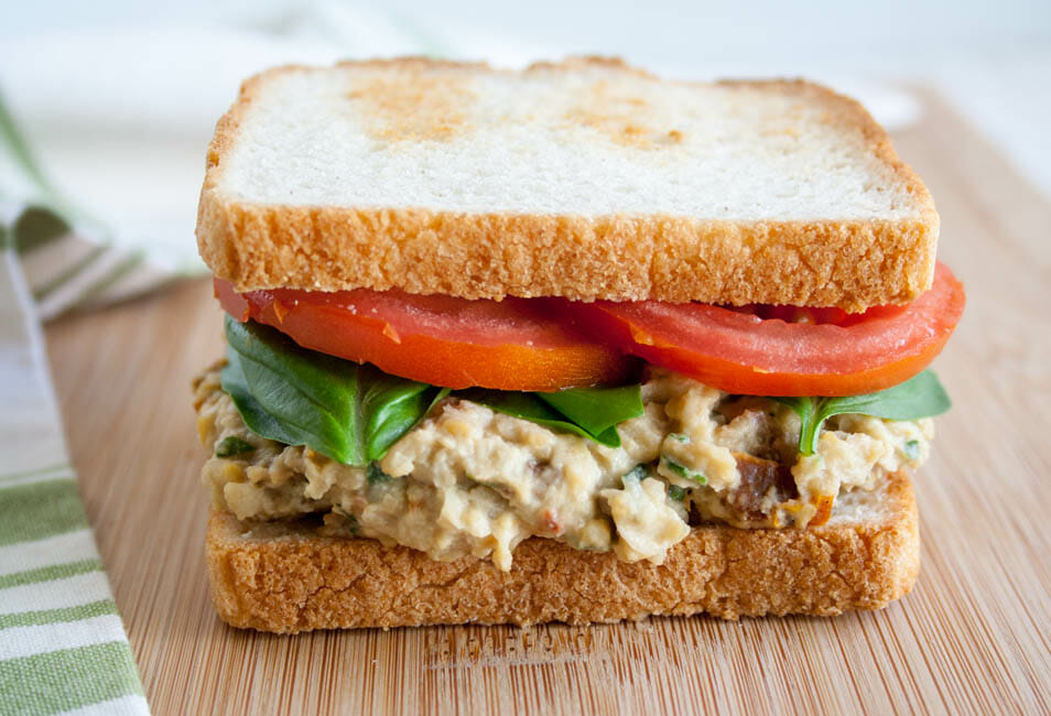 Sun-Dried Tomato and Basil Chickpea Salad Sandwich close up.