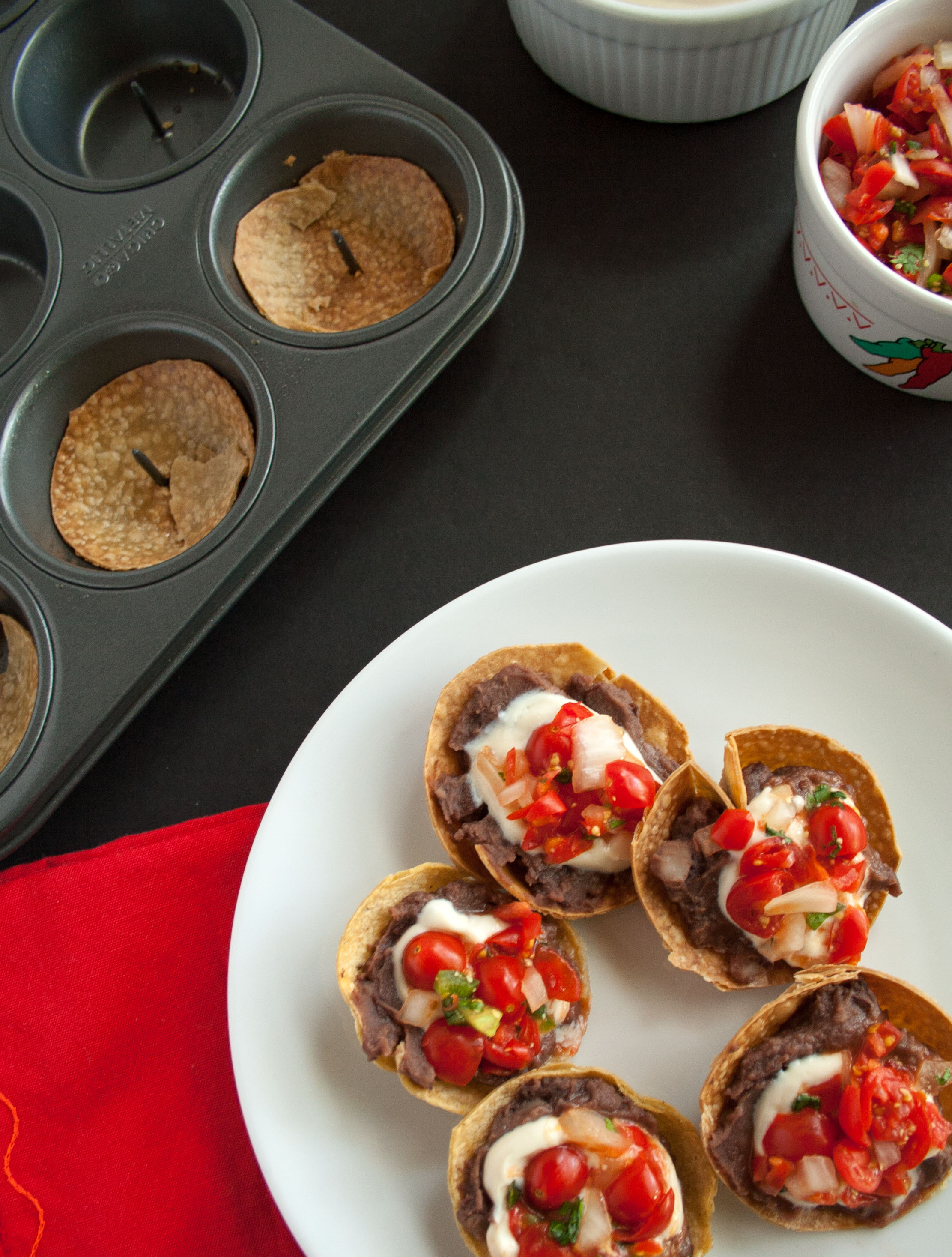 Mini Bean Tostadas with Pico de Gallo and Vegan Sour Cream birds eye view.
