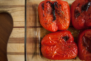 oven roasted red peppers on cutting board