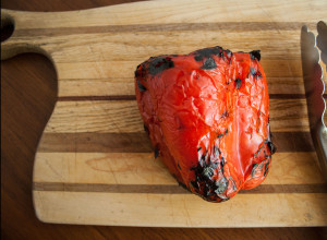 stovetop roasted red peppers on cutting board