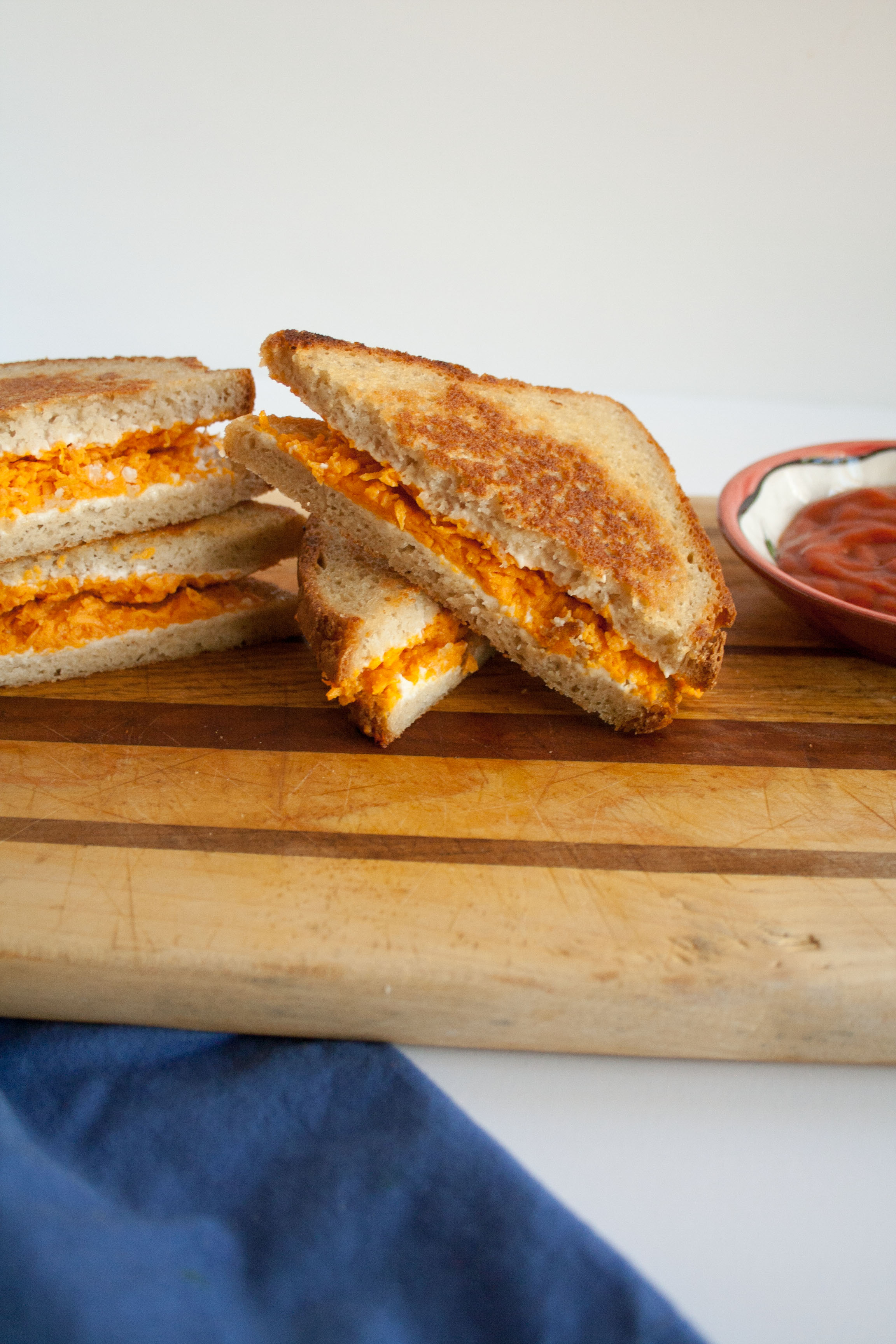Vegan Grilled Cheese on cutting board.