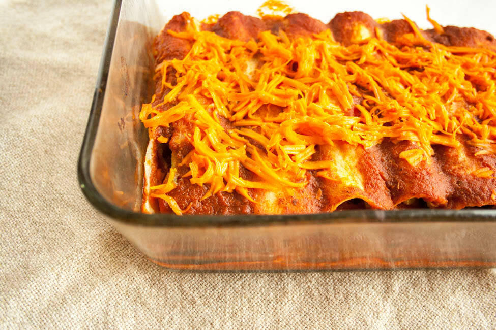 Bean and Corn Enchiladas in baking dish.