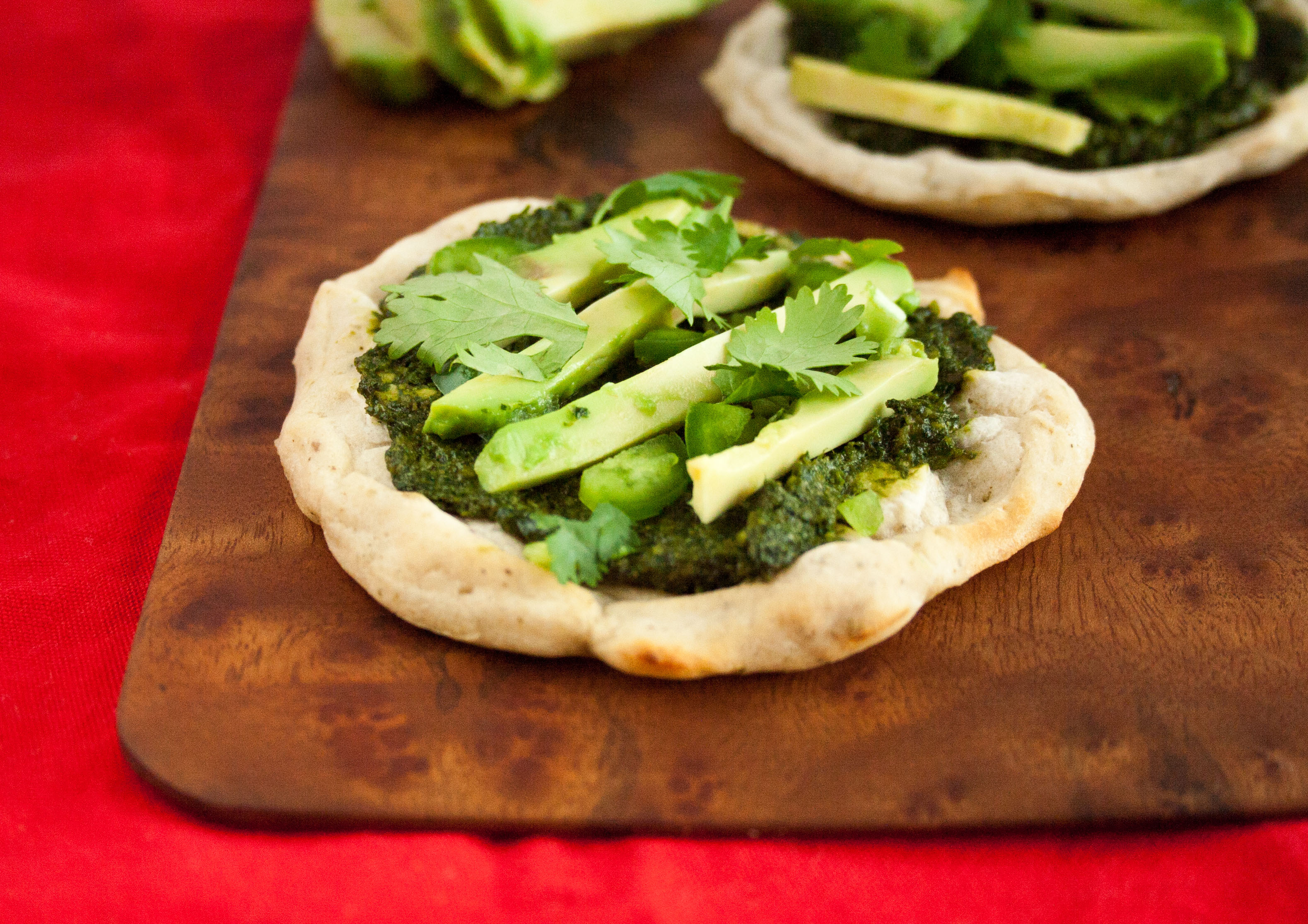 Mini Pizzas with Cilantro Pesto and Avocado close up.