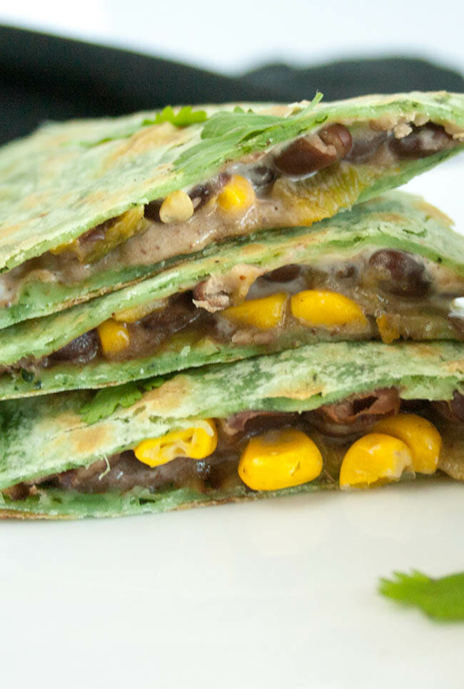 Black Bean and Corn Vegan Quesadilla slices stacked close up.