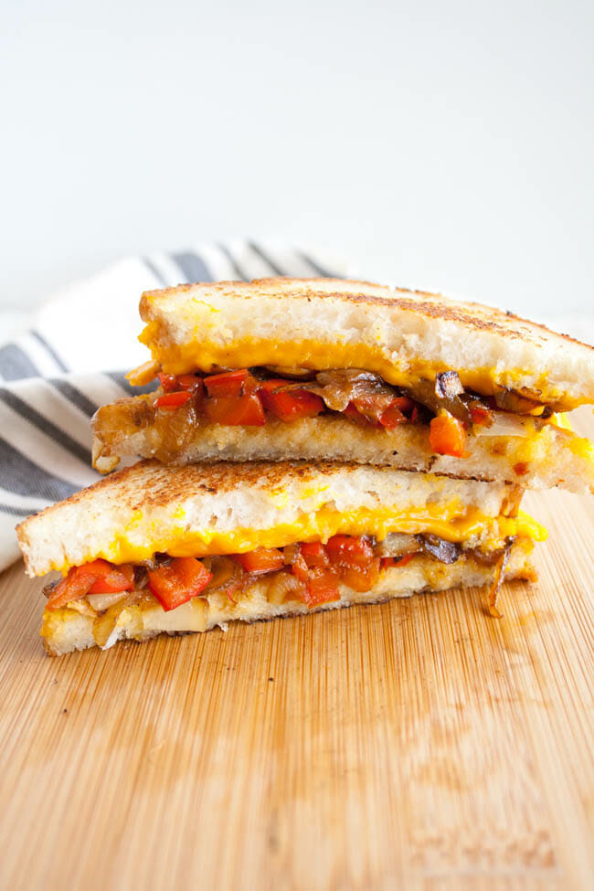 Vegan Grilled Cheese with Caramelized Onions and Red Pepper on cutting board