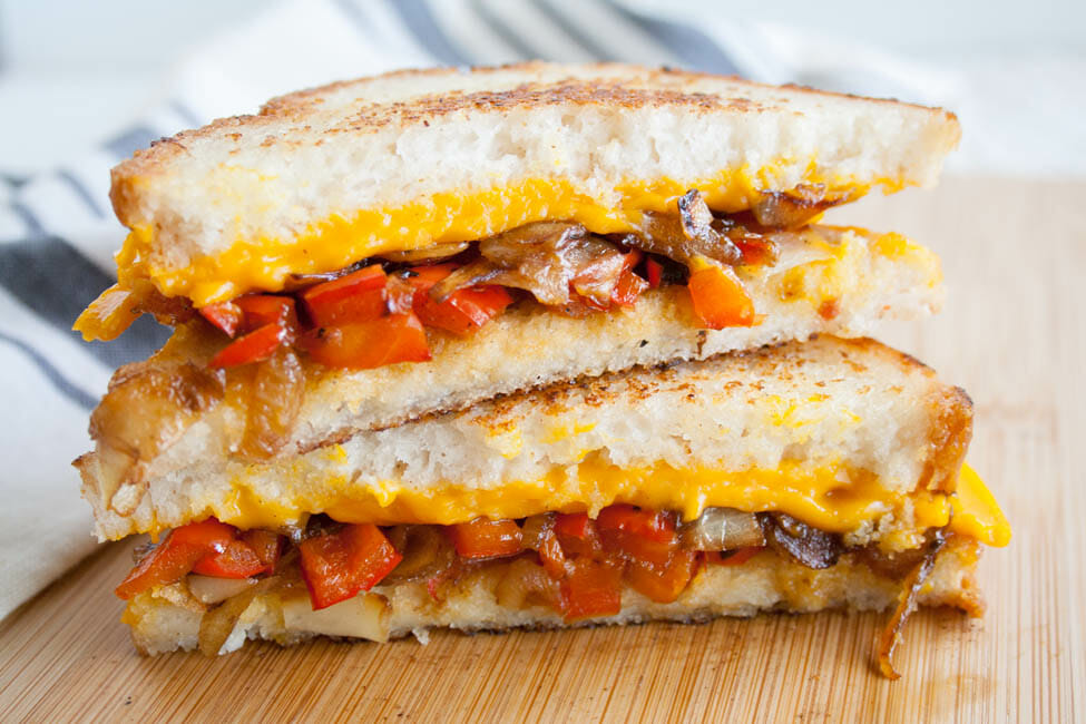 Vegan Grilled Cheese with Caramelized Onions and Red Pepper close up.