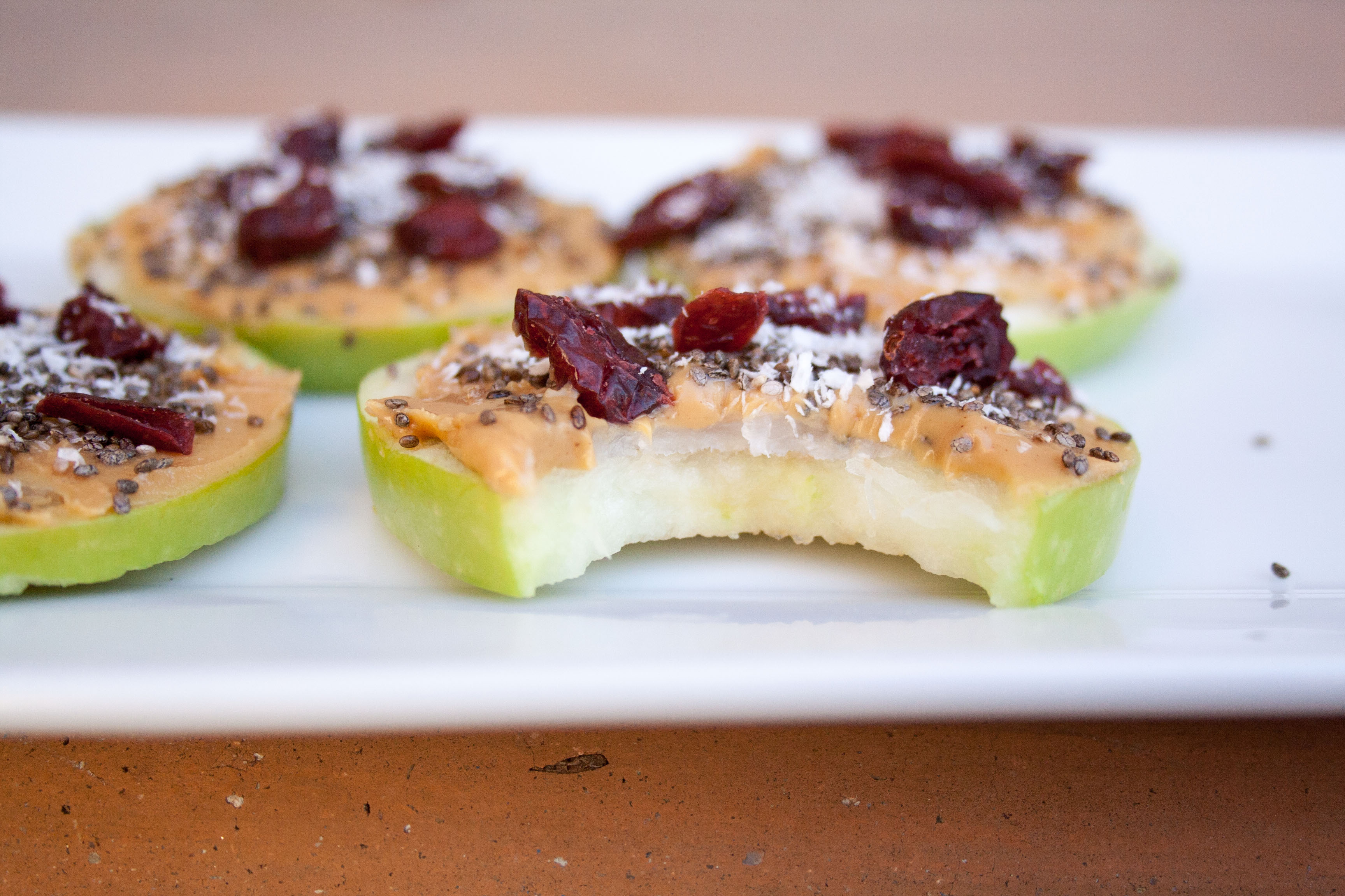 Coconut Peanut Butter Apple Pizzas with bite