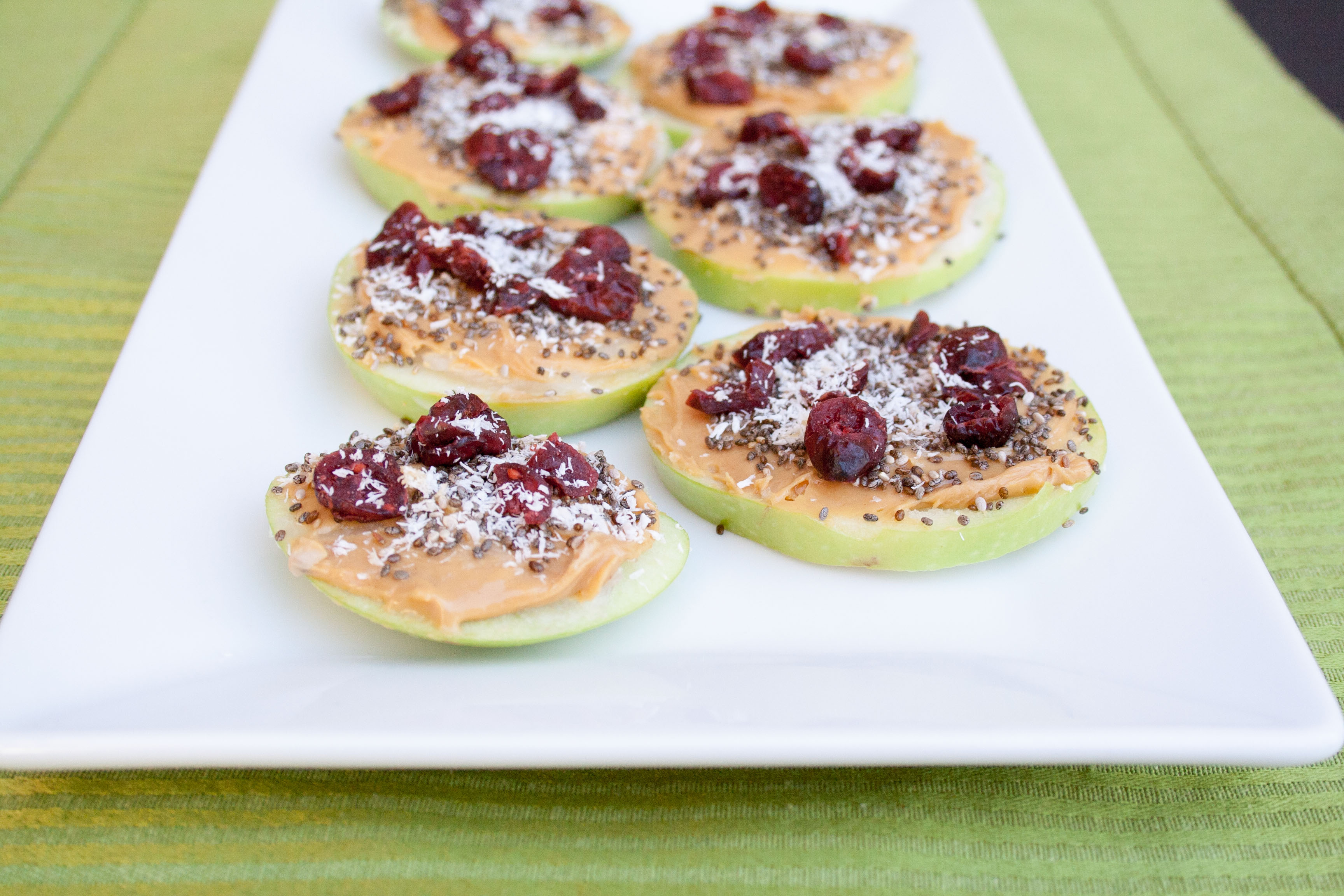 Coconut Peanut Butter Apple Pizzas on plate.