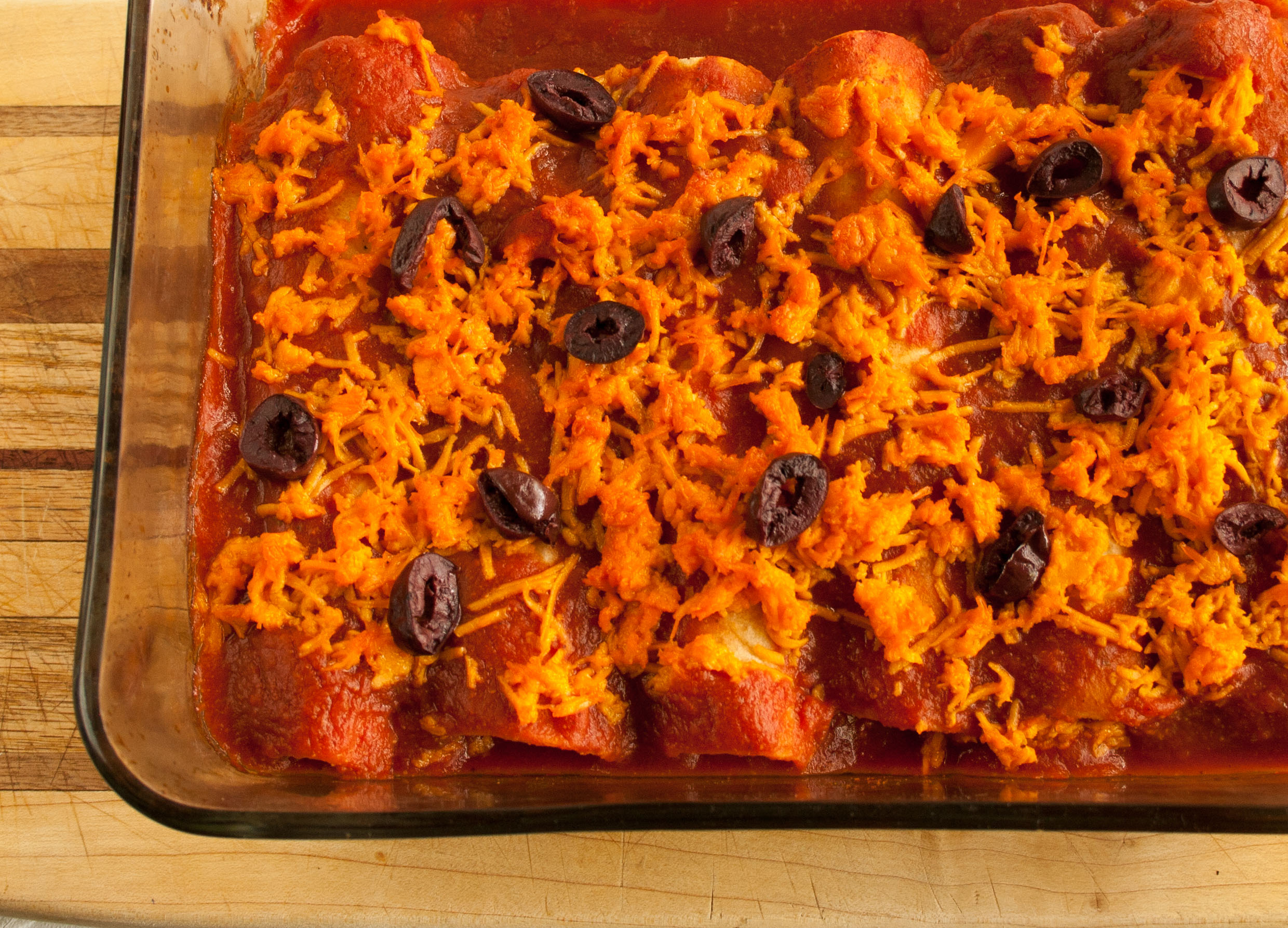 Jackfruit Enchiladas birds eye view of enchiladas in baking dish.