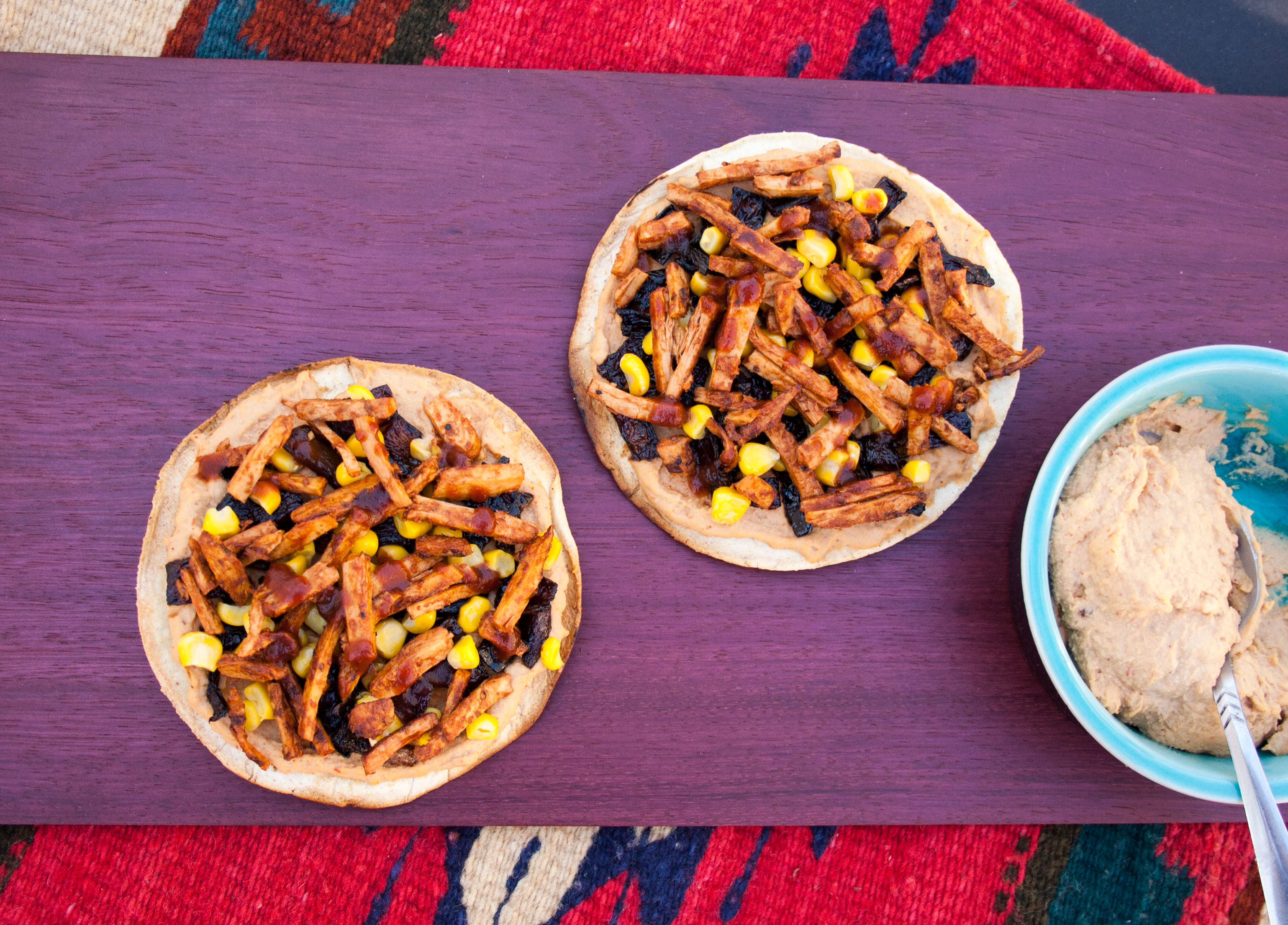 Vegan BBQ Tostadas with Chipotle Hummus and Caramelized Onions birds eye view.