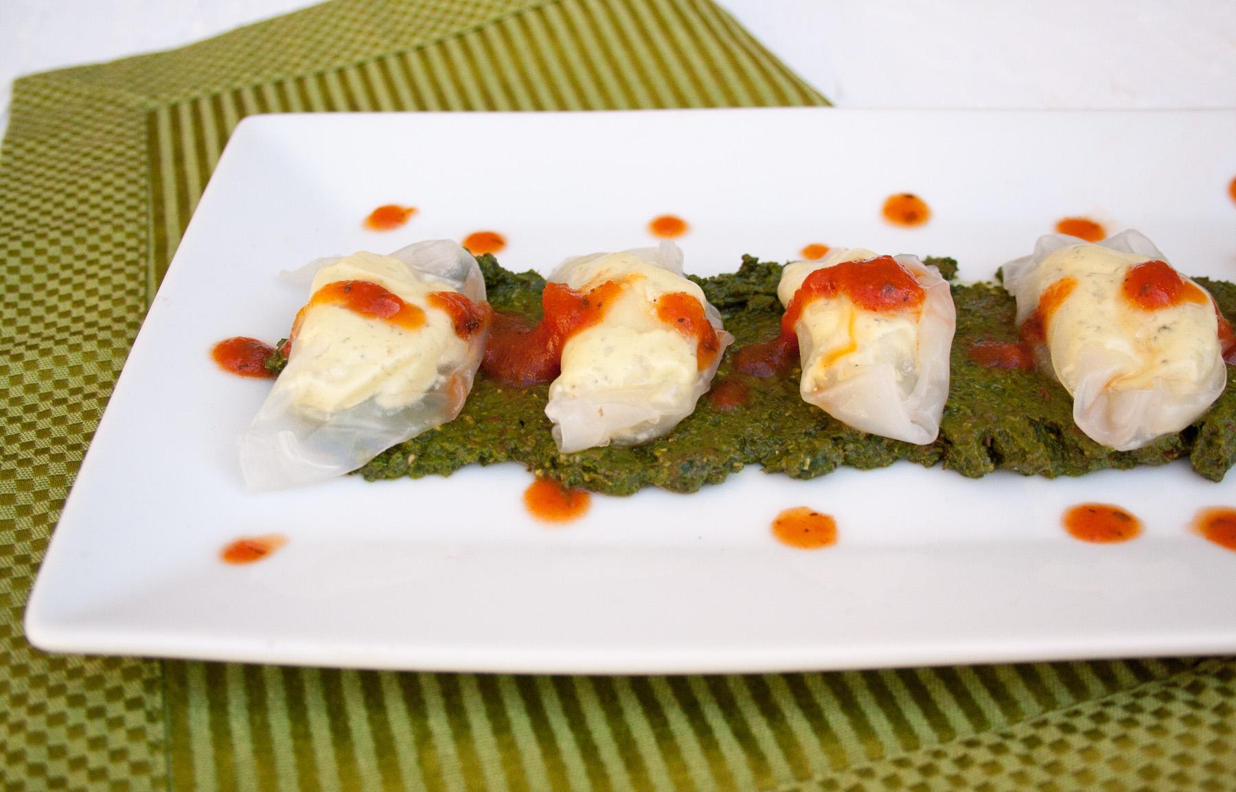 Tofu Ricotta Ravioli with Sun-Dried Tomato Basil Pesto close up.
