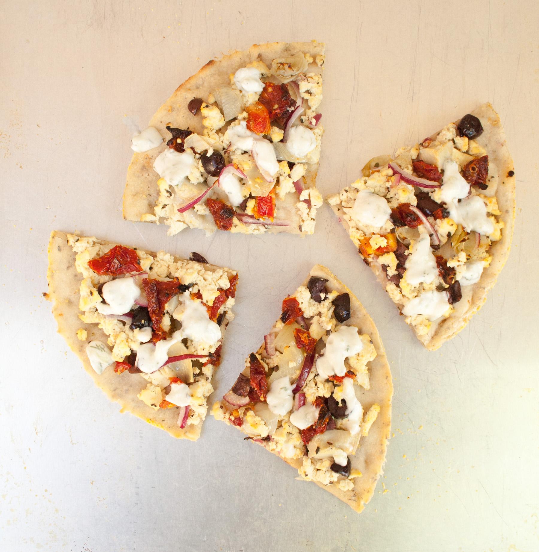 Tofu Feta and Sun-Dried Tomato Pizza with Vegan Tzatziki birds eye view.