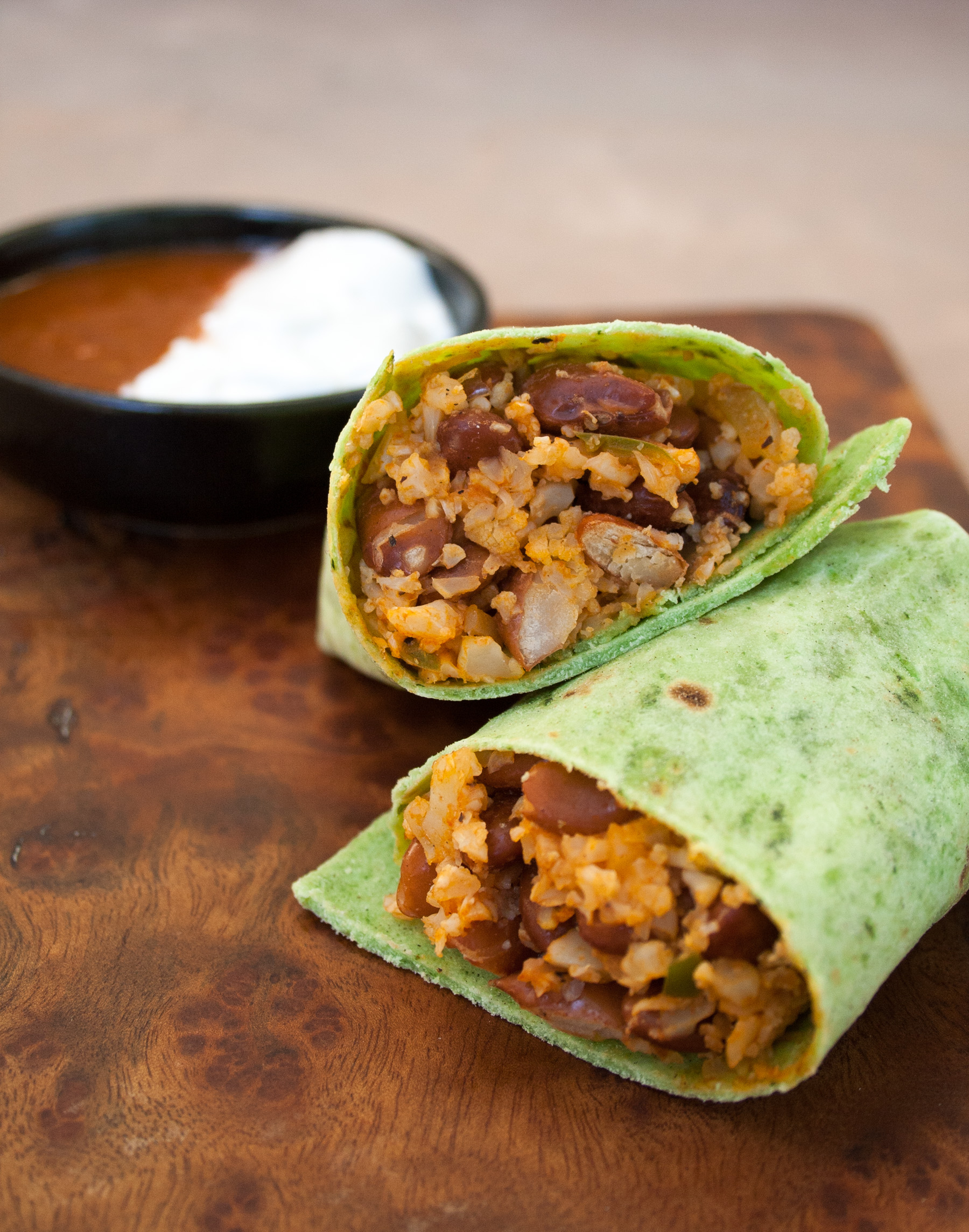 Bean and Mexican Cauliflower Rice Burritos on cutting board