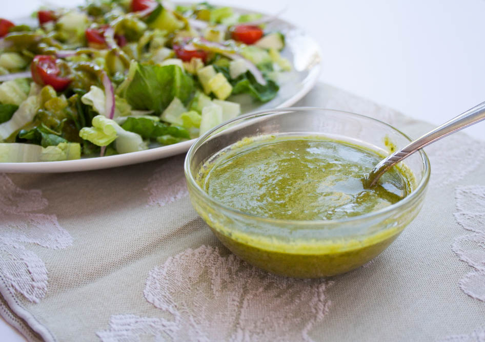 Dill Vinaigrette with Basil and salad in the background.