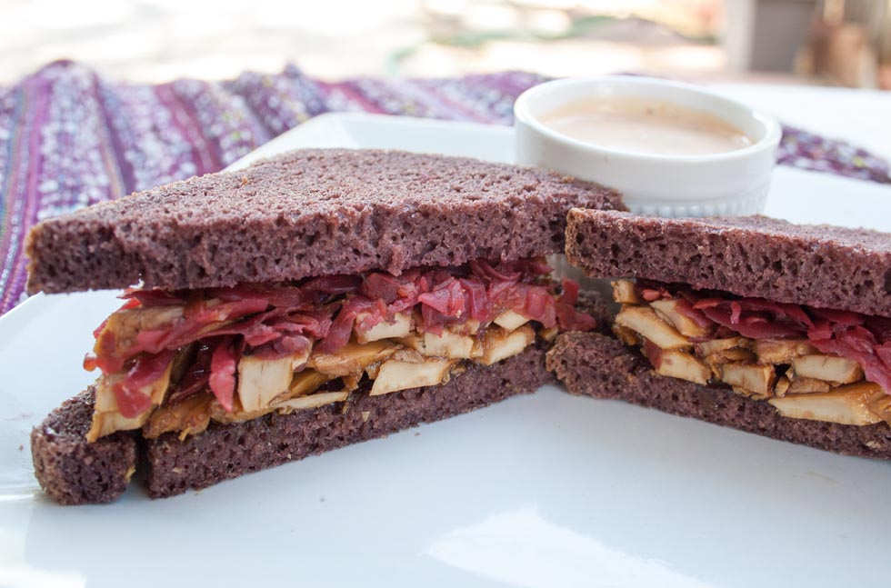 Vegan Teriyaki Reuben with Spicy Thousand Island Dressing close up.