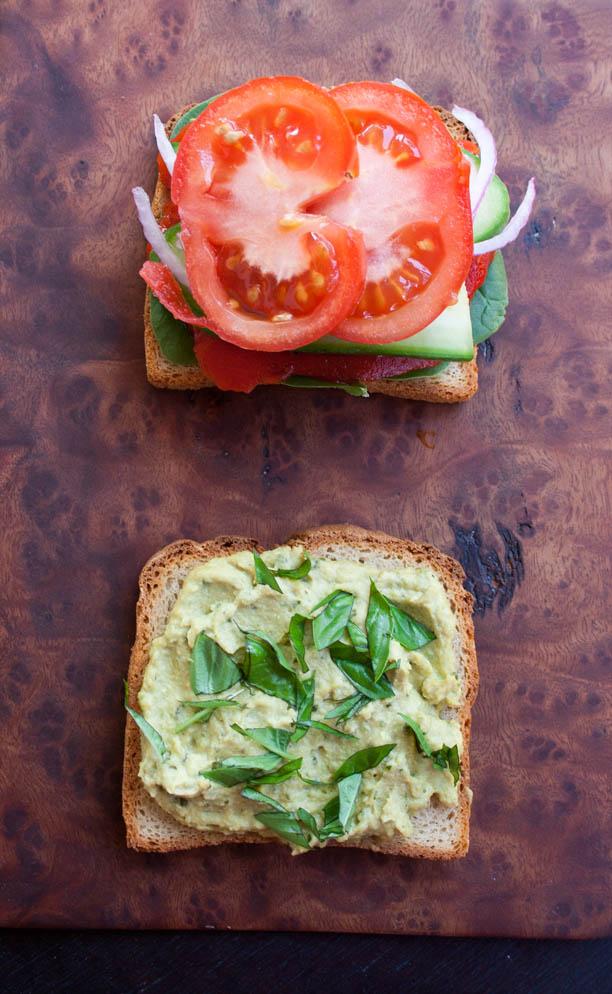 Veggie Sandwich with Basil Pesto Hummus birds eye open faced.