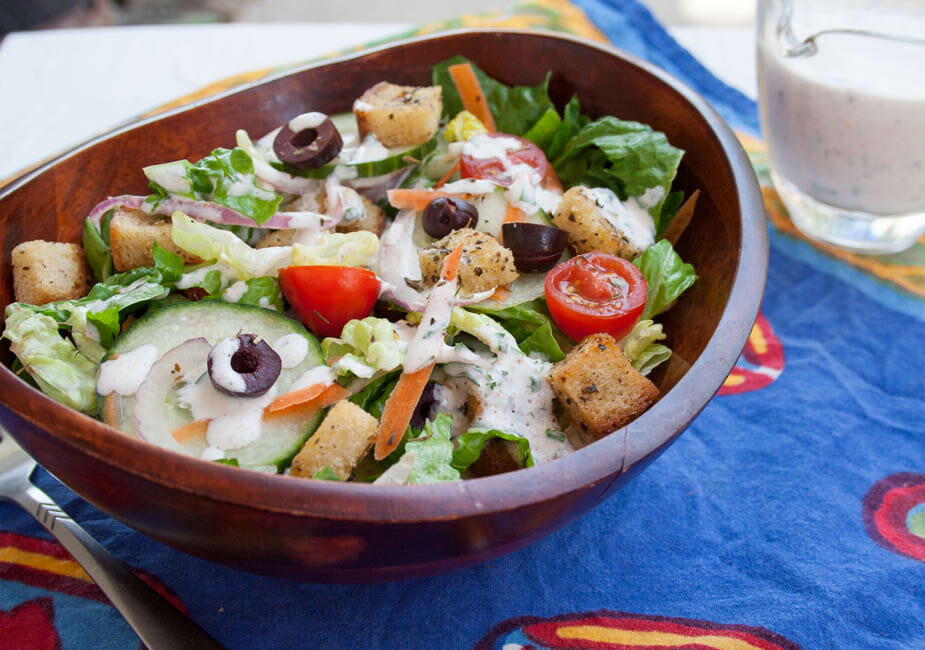 Garden Salad with Herbed Croutons and Vegan Ranch Dressing close up.