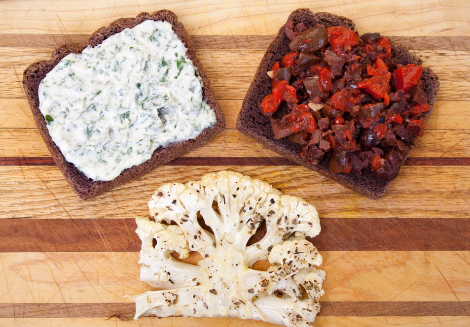 Roasted Cauliflower Steak Sandwich with Red Pepper and Black Olive Tapenade birds eye view.