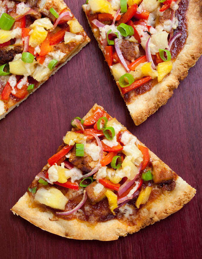 Vegan Hawaiian BBQ Pizza birds eye view of three slices.