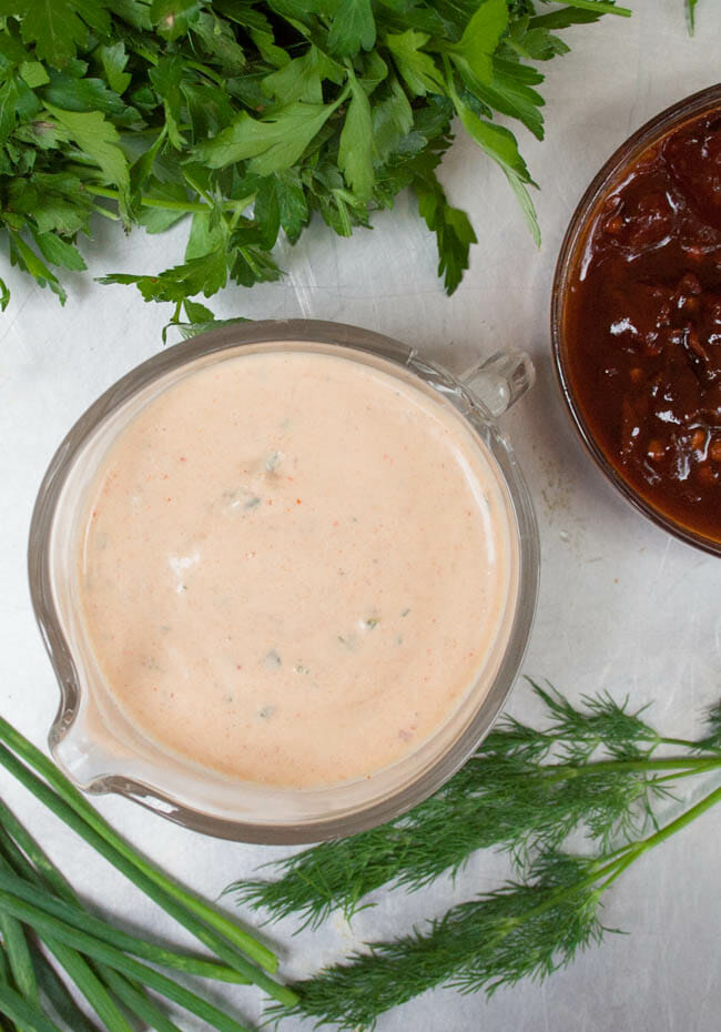 Vegan Chipotle Ranch Dressing birds eye view with herbs and chipotle peppers