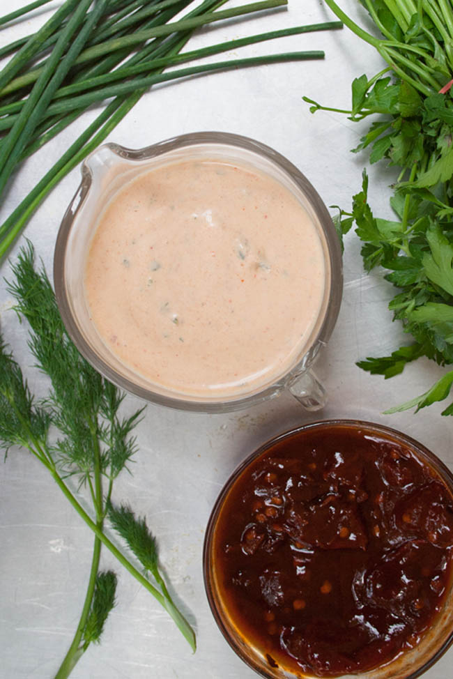 Vegan Chipotle Ranch Dressing birds eye view with bowl of chipotle peppers and herbs.