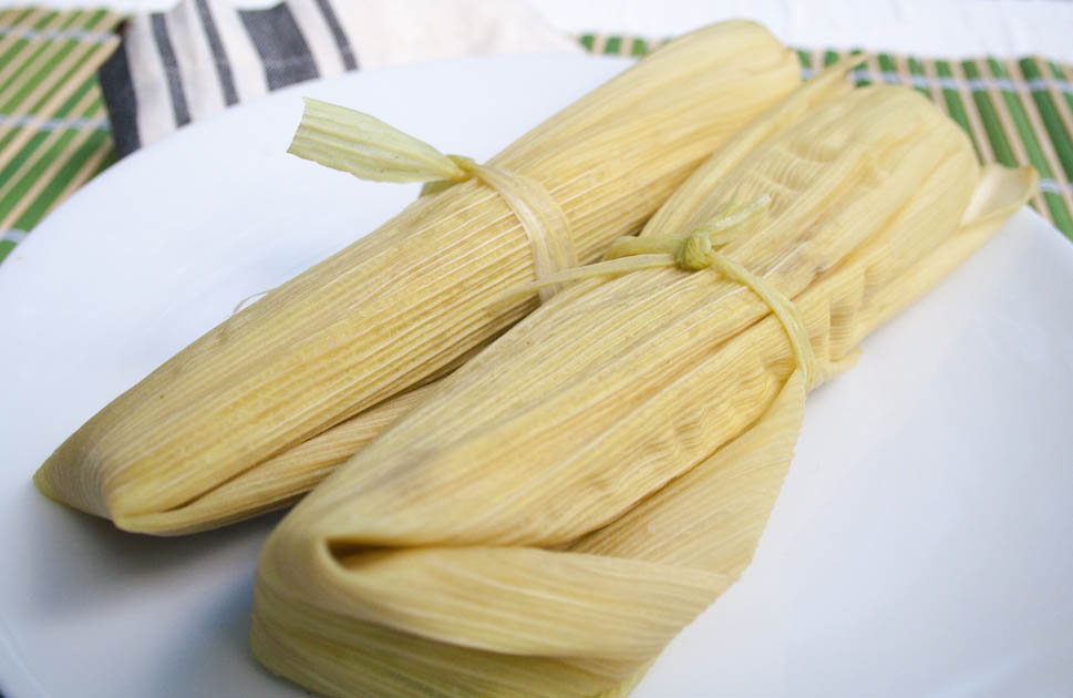 Corn Tamales on a plate.