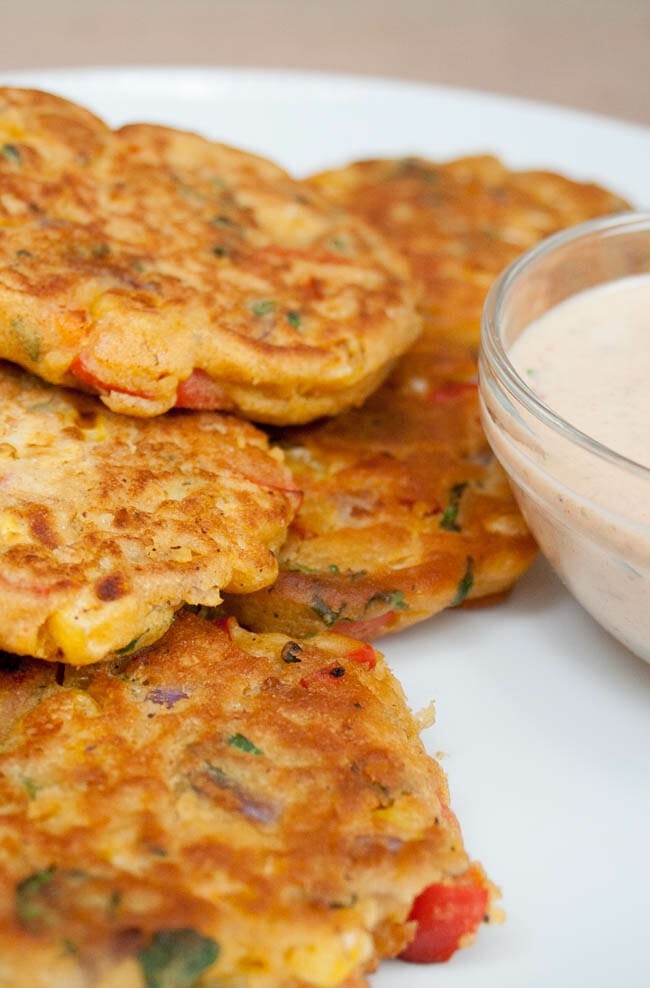 Vegan Chickpea Fritters vertical close up with Vegan Chipotle Ranch Dressing.