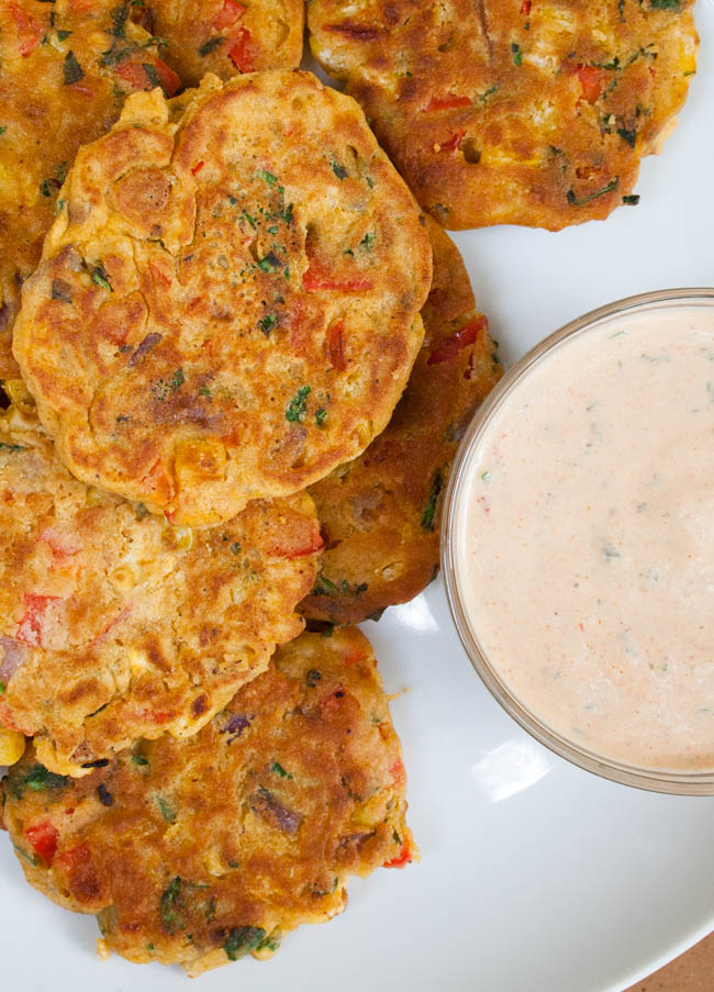 Vegan Vegetable Fritters vertical birds eye view with vegan chipotle ranch dressing.