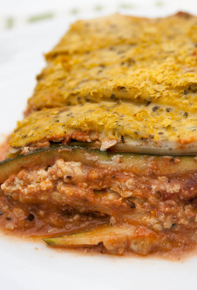 Vegan Zucchini Lasagna with Tofu Ricotta and Walnut Sauce vertical close up.