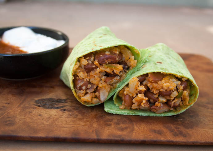 Bean and Mexican Cauliflower Rice Burritos on cutting board.