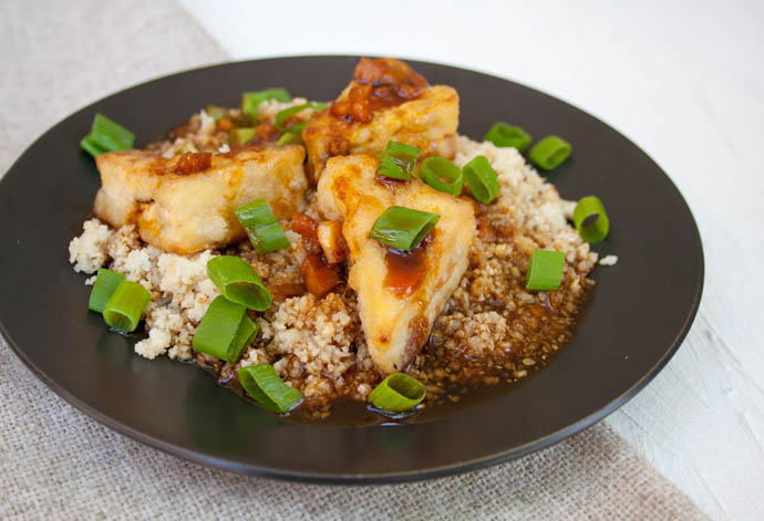 Crispy Teriyaki Tofu and Cauliflower Rice on a plate.