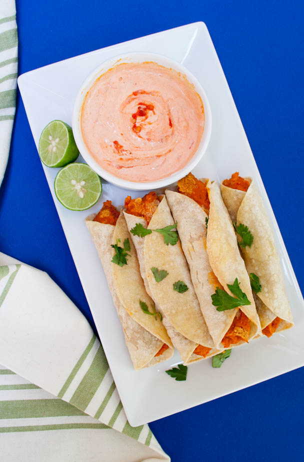 Chickpea and Roasted Red Pepper Taquitos with Harissa Cream birds eye view.