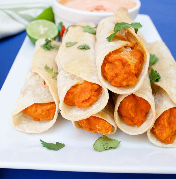 Chickpea and Roasted Red Pepper Taquitos with Harissa Cream