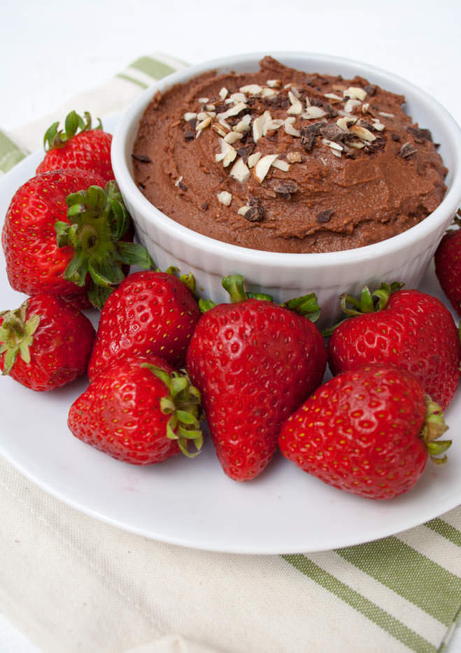 Dark Chocolate Hummus pictured with strawberries.