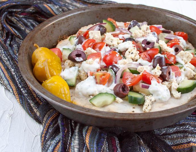 Greek Pizza with Tofu Feta close up.