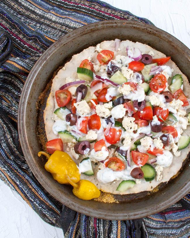 Greek Pizza with Tofu Feta birds eye view.